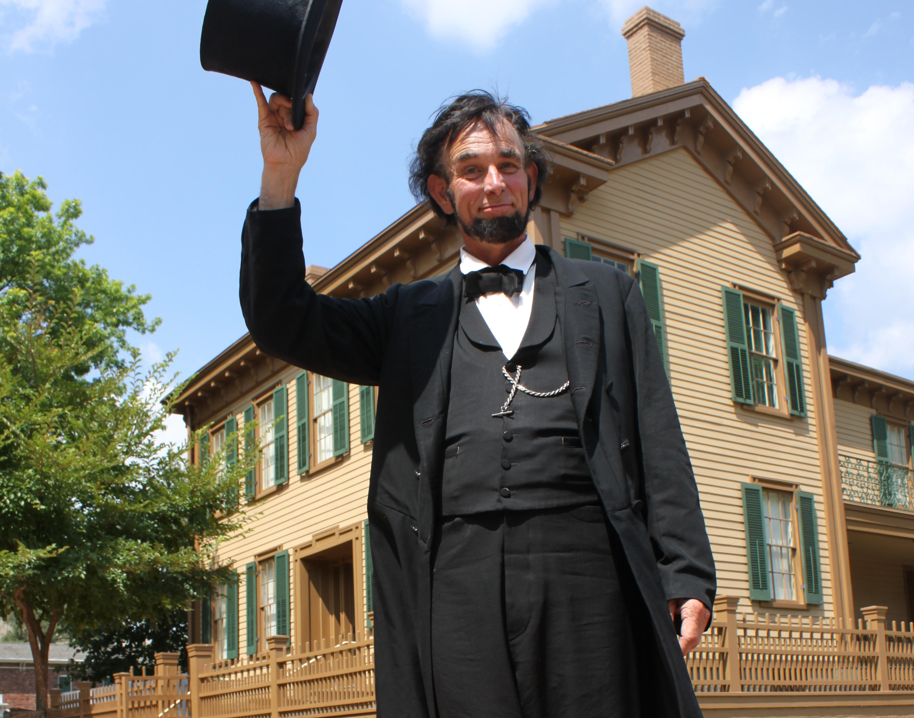 Actor portraying Abraham Lincoln in front of home