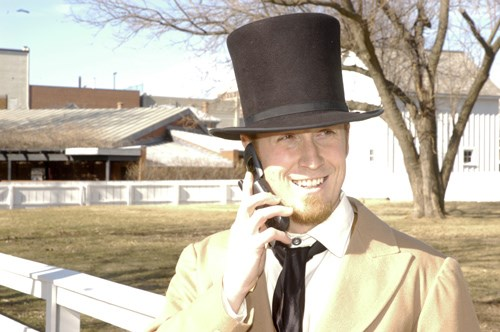 Lincoln Home NHS Living History Ranger with cell phone