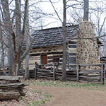 log cabin with log fence