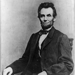 black and white portrait of lincoln from waist up; seated