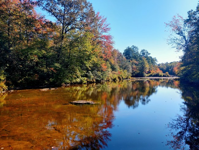 Blue Hole, a calm spot in the river with fall color beginning to show on the trees.