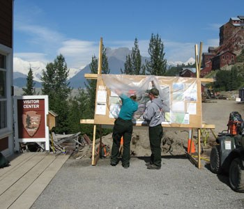 Information Officers posting Chakina Fire maps on an information board in Kennecott, Wrangell-St. Elias NP, 2009