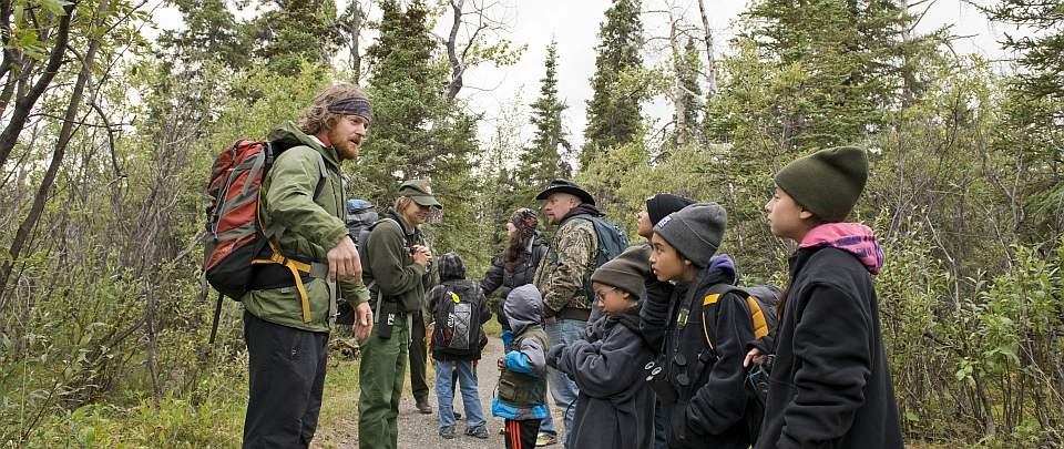 a ranger speaks to families on a trail at denali family camp