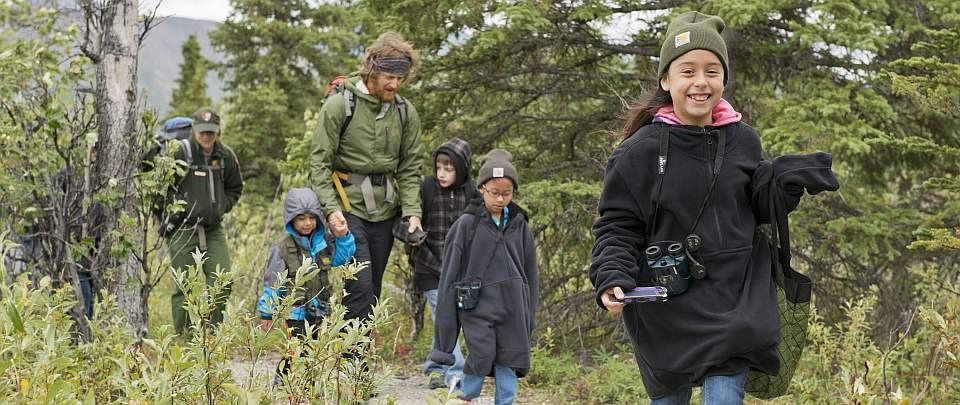 children walk along a trail with park rangers during Denali Kids Camp