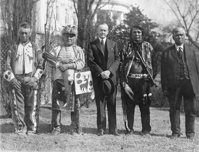 U.S. President Calvin Coolidge with four Osage Indians after Coolidge signed the bill granting Indians full citizenship.