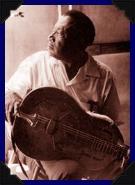 Bukka White with guitar