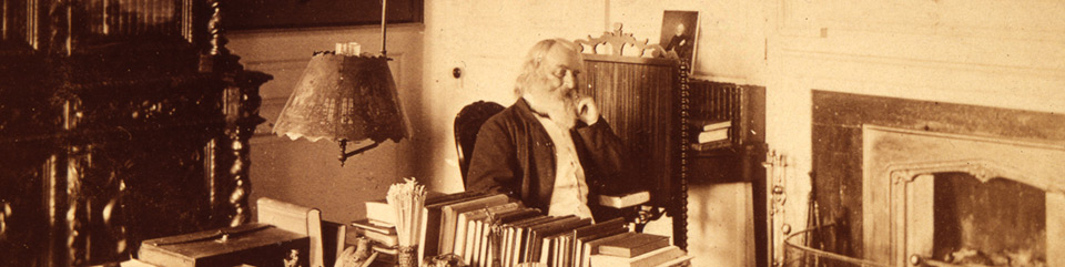 Henry Wadsworth Longfellow in his study, circa 1875.
