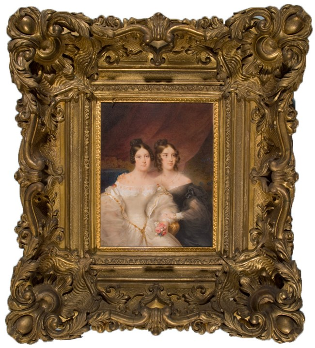 Portrait of two women, one in a white dress, one in a black dress, in a large gilt frame