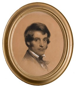 Bust-length portrait of man in charcoal and chalk in oval gold frame