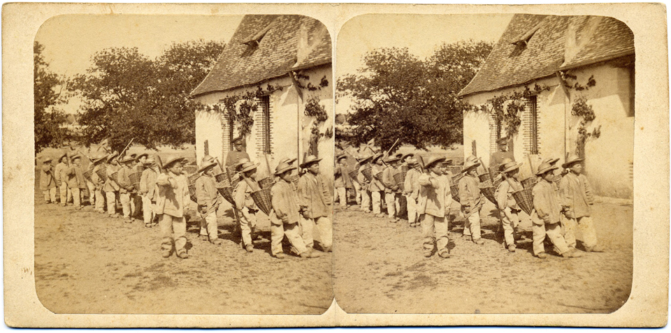 A stereograph card showing boys at the Mettray Penal Colony in France.