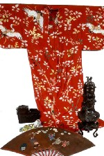 A Japanese kimono and fan, and Asian bronze and ceramic works collected by Charles A. Longfellow.