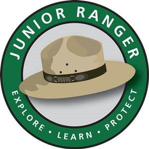 "Logo with ranger hat in green circle and motto ""Explore Learn Protect"""