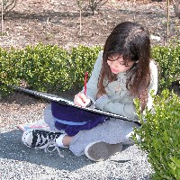 A young visitor completes an activity in the historic garden.