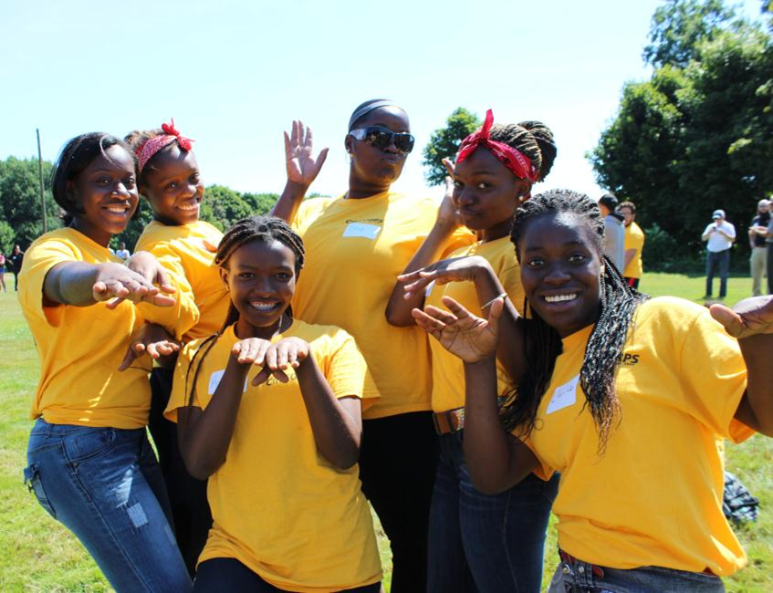 A group of young women doing amusing poses for the camera.