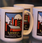 A collection of drinking mugs with a picture of a mill and the words Lowell National Historical Park written on them.