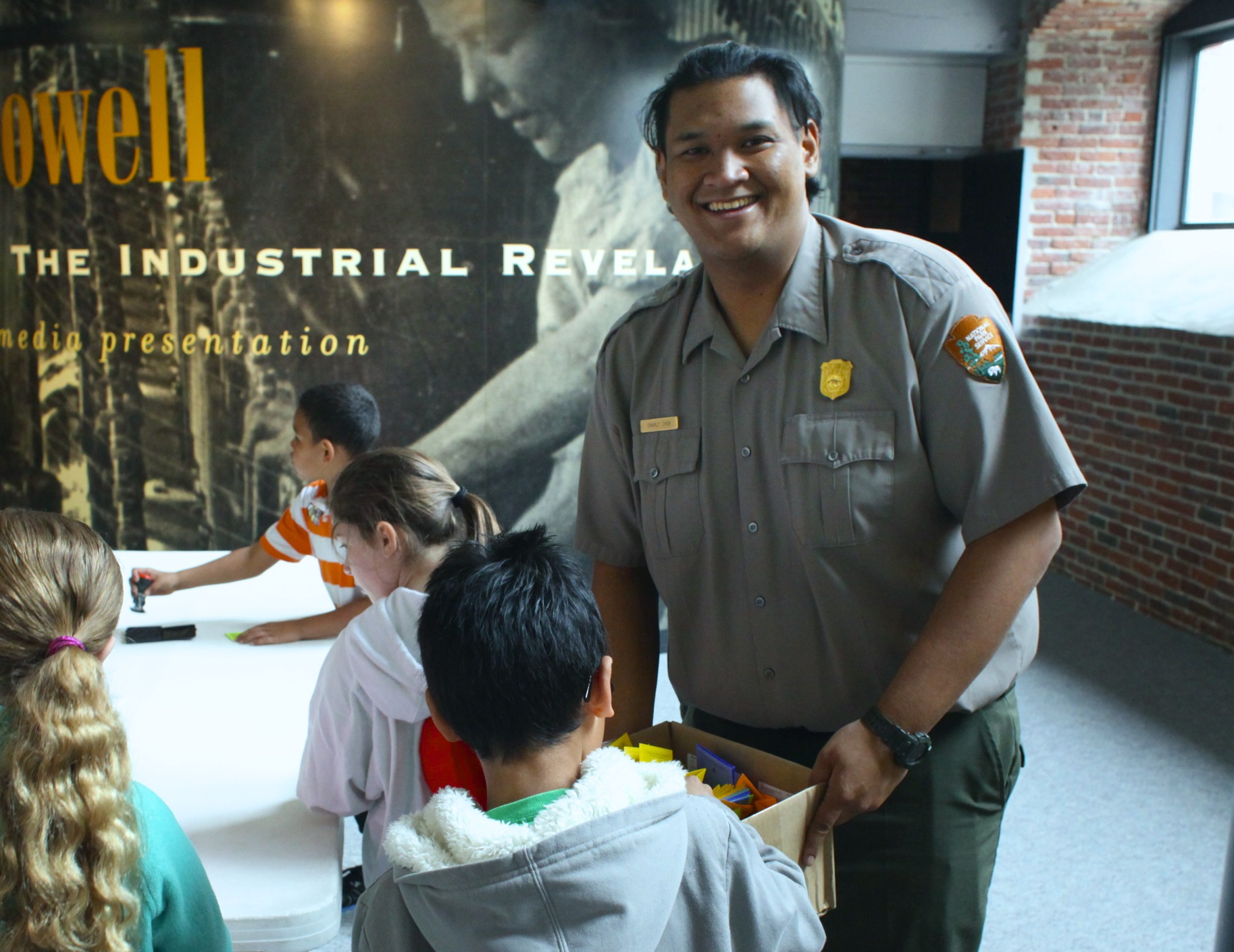 A Park Ranger helps kids with a craft