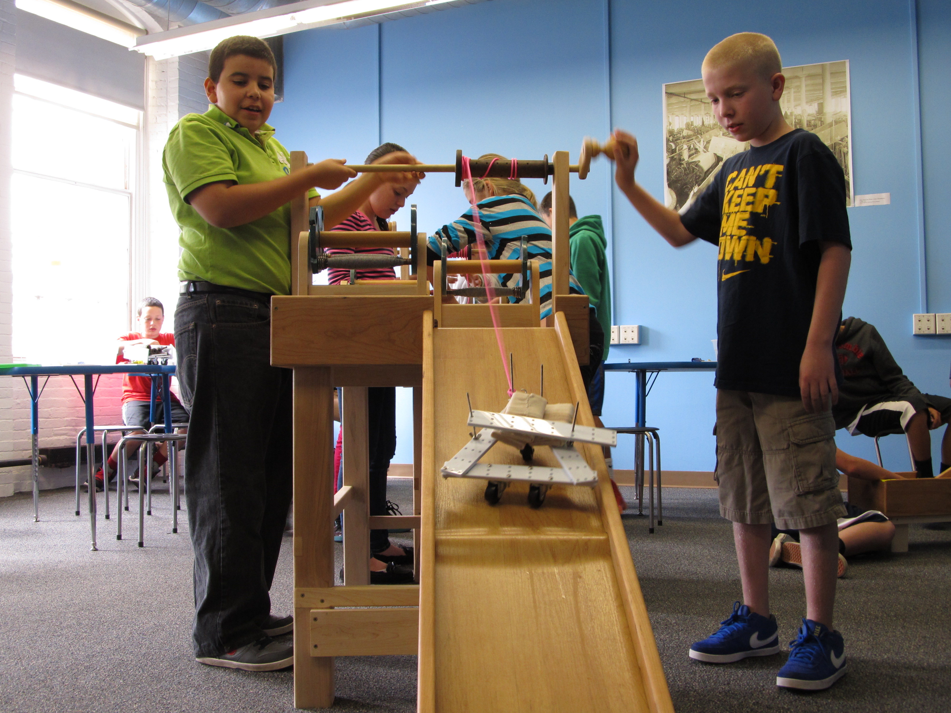 Two students work on an engineering project