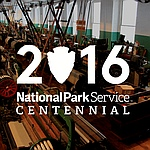 NPS Centennial logo with Boott Mills Weave Room background