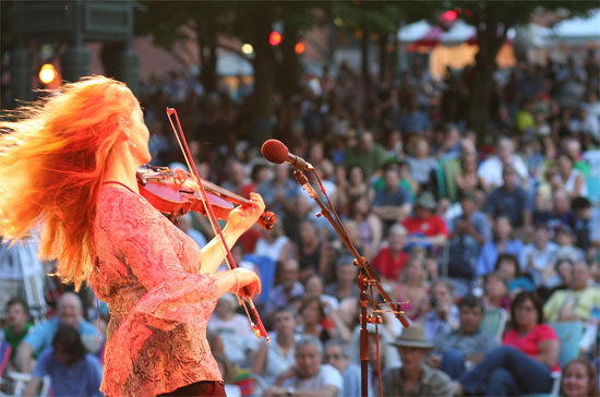"""Irish musician Niamh Ni Charra plays to a packed house at Boarding House Park, one of six performance venues at the 2009 Lowell Folk Festival"""