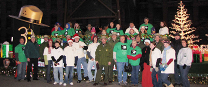 Lowell National Historical Park volunteers and staff with holiday float