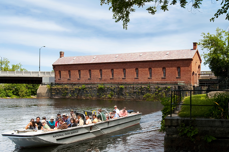 Canal boat tour in Lowell with gatehouse in background
