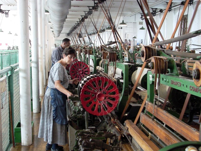 Weavers at work on the looms