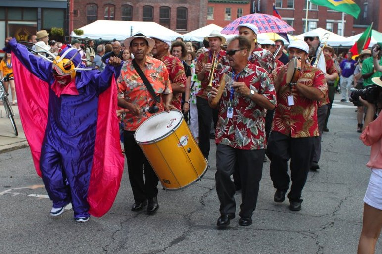 Jorge Arce and Comparsa Boricua leading the parade for the 26th Lowell Folk Festival, Friday, July 27, 2012.