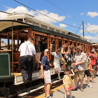 Visitors boarding historic trolleys