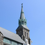 A picture of the green and grey bell tower of Saint Patrick's church