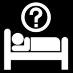 A stick figure lying in bed