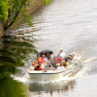 Visitors and captain on a boat tour of the canals