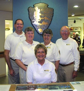 Park volunteers greet visitors at the information desk.
