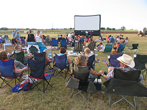 Visitors enjoy a movie under the stars at the LBJ Ranch.