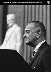 President Johnson with Lincoln statue in background.