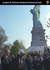 President Johnson with Statue of Liberty