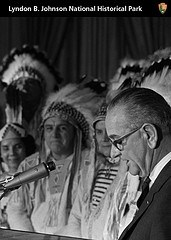 Native Americans watch as President Johnson delivers a speech.