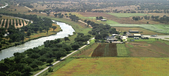 Aerial view of the Pedernales River and LBJ Ranch looking west (1967)