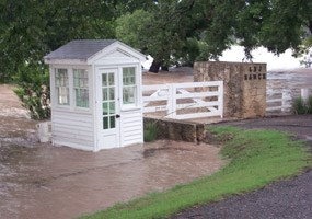 Original Ranch entrance gate engulfed in flood water (2002)