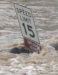 Speed Limit sign engulfed by Pedernales flood water