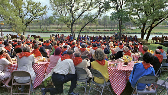 Guests attired in red bandanas enjoy entertainment during the 1967 barbecue on the LBJ Ranch