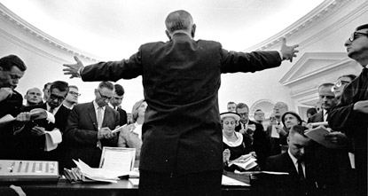 President Johnson faces the press in the Oval Office