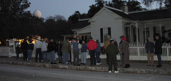 Visitors wait to enter the Boyhood Home, decorated for Christmas.