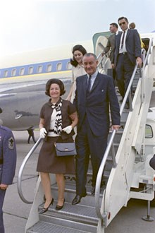 President and Mrs. Johnson leaving airplane.