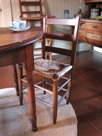 The Birthplace's original rawhide chair.  Mrs. Johnson's Roycrafter high chair is in the background.
