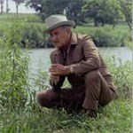 LBJ in grass near river