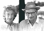 Black and white portrait of Mary and Laurance Rockefeller, she on the left, he in a hat and black-rimmed glasses.