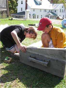 Students construct a solar dehydrator at the King Farm K Robbins