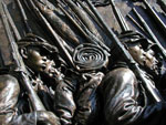 Detail of soldiers from the sculpted Shaw Memorial of the 54th Massachusetts Regiment.