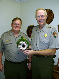 Superintendent Patrick Reed and Ranger John Yakel with Mammoth Cave NP Christmas Ornament