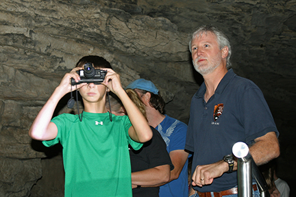 Visitors watch bats with night-vision goggles.